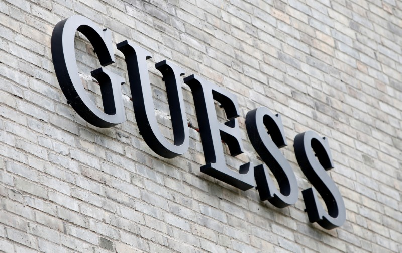 """""""FILE PHOTO: The logo of Guess is seen on an outlet store in Metzingen, Germany, June 16, 2017. REUTERS/Michaela Rehle""""的图片搜索结果"""